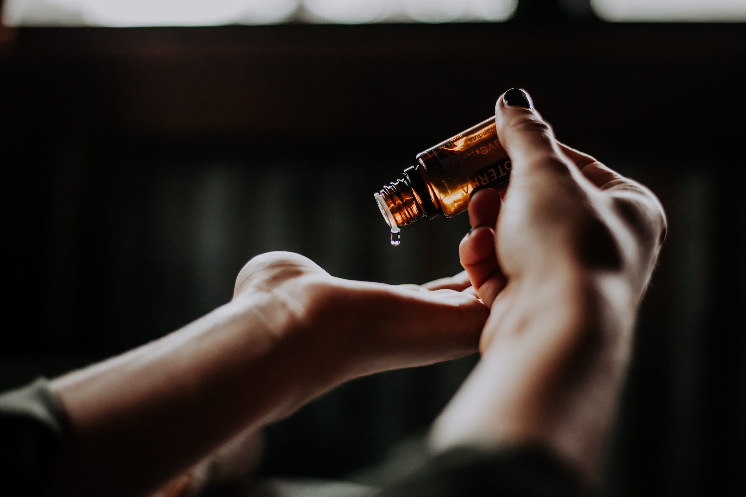 CBD oil bottle on hands