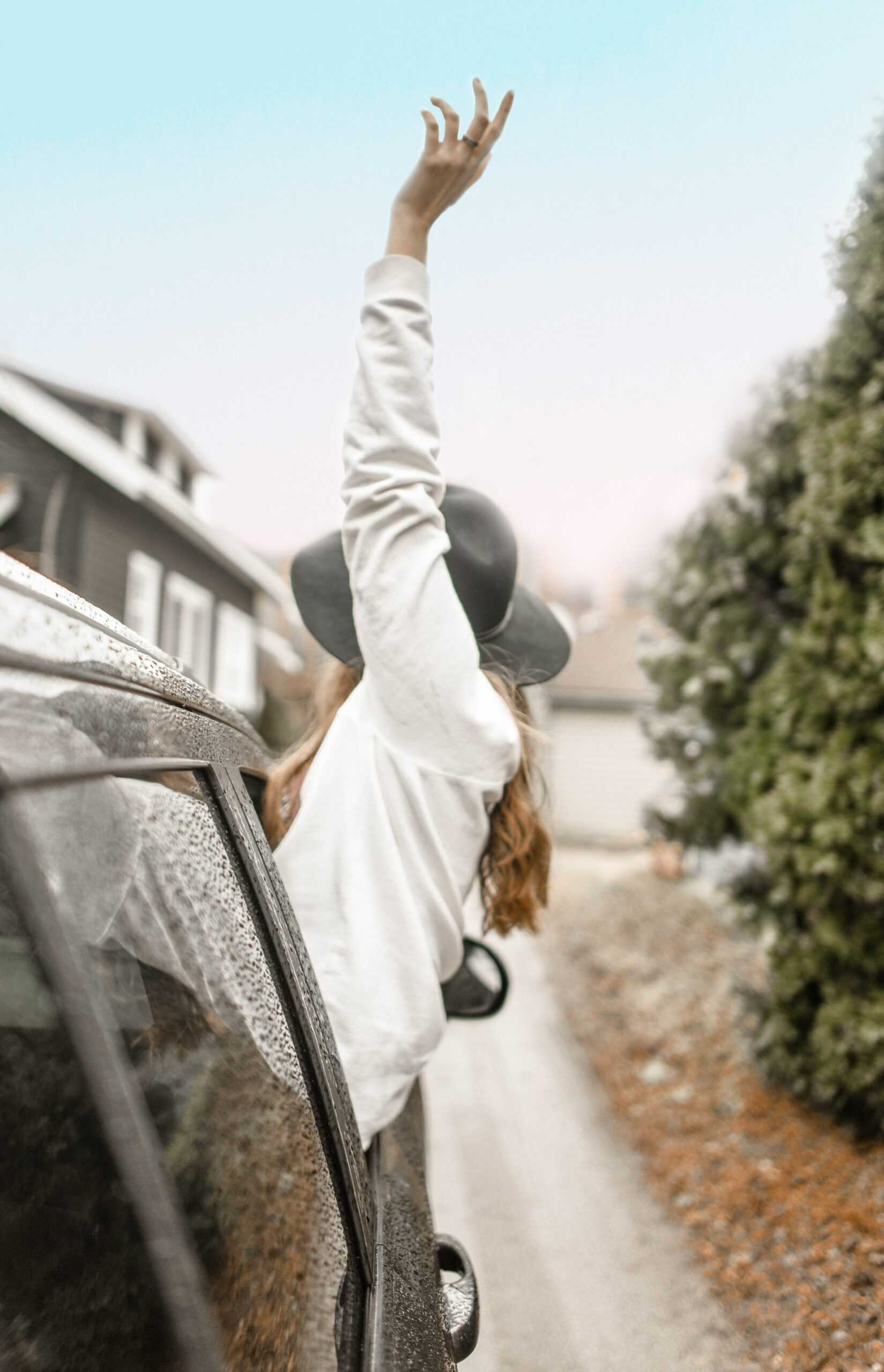 girl hanging out of a car high
